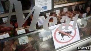 "A ""no horsemeat"" sign is exhibited alongside meats in the window of Bates Butchers in Market Harborough, central England"
