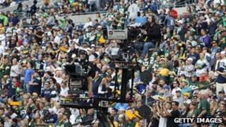 ESPN camera crews in place for an American Football game