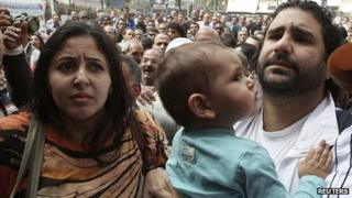 Alaa Abdel Fattah with wife and child outside prosecutor's office in Cairo. 26 March 2013