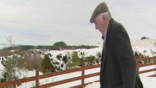 Brendan Kelly in snow at his farm