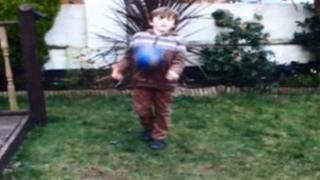 Child playing football