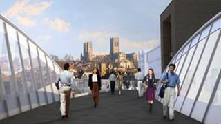 A mock-up image showing people using the proposed bridge.