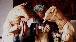 Three Armagh Rhymers in animal masks