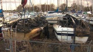 Burnt out yachts at Wells-next-the-Sea