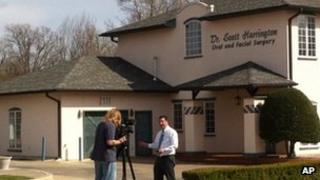 A journalist stands outside the dental practice of Dr W Scott Harrington in Tulsa, Oklahoma 28 March 2013