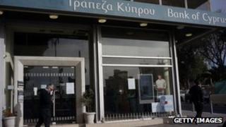A man walks near a Bank of Cyprus branch in Nicosia. Photo: 28 March 2013