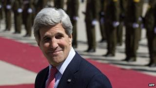 US Secretary of State John Kerry arrives prior to an official arrival ceremony by Palestinian President Mahmoud Abbas in Ramallah 21 March 2013