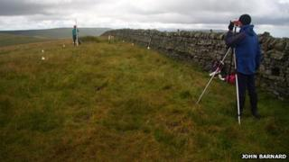 Amateur surveyors John Barnard and Graham Jackson locating the summit of Thack Moor
