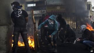 Palestinians clash with Israeli soldiers in Hebron on Thursday 4 April