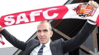 Paolo Di Canio with a Sunderland scarf after being named the club's manager