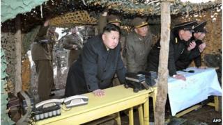 North Korean leader Kim Jong-Un (centre) inspecting landing drills, 25 March 2013