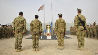 The 1 Scots flag being lowered