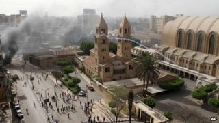 A tear gas canister is fired by Egyptian riot police into the compound of the Coptic Orthodox Cathedral, Cairo