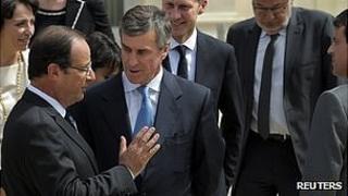 President Francois Hollande (left) talking to ex-budget minister Jerome Cahuzac, 3 Apr 13