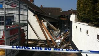 Considerable damage has been caused to a wall and roof at the back of the premises