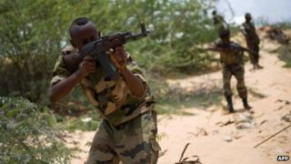 Somali soldiers take part in a training exercise on 28 March 2013 at a camp on the outskirts of Mogadishu, Somalia