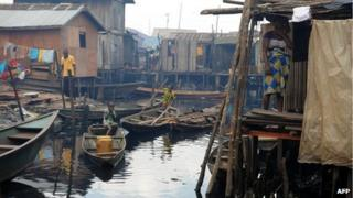 Children on boats in a shanty town in Lagos (30 August 2012)