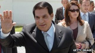 Former Tunisian President Zine el Abidine Ben Ali followed by his wife Laila Trabelsi