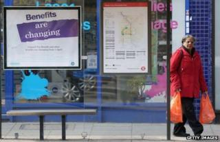 Bus stop with poster about benefit changes