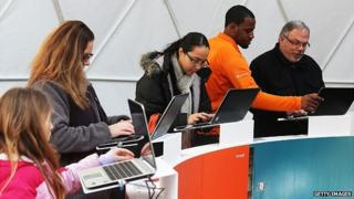 Members of the public try Office 2013 at the product's launch event