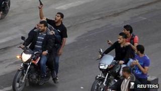 Armed men drag body of suspected collaborator through Gaza's streets. 20 November 2012