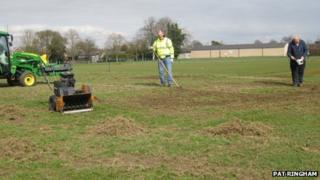 Damaged cricket pitch in March
