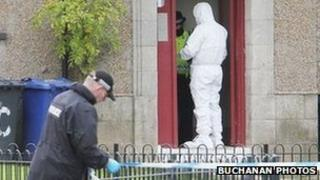 police forensic officer at the scene