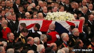 Lady Thatcher's coffin moves slowly down the central aisle of St Paul's Cathedtral