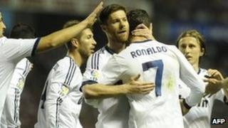 Real Madrid players celebrating after scoring a goal