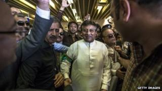Former Pakistani president Pervez Musharraf is greeted by supporters after landing on Pakistani soil at Jinnah International airport on 24 March 2013 in Karachi