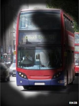 A bus as seen through a pair a special glasses used to simulate the vision experience by a partially sighted person