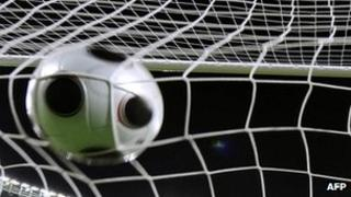 Football in goal netting, file picture