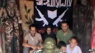 Still from the video alleged to show the French victims