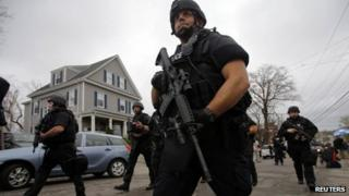 Police officers search house to house for Dzhokhar Tsarnaev, the surviving suspect in the Boston Marathon bombings, in a neighbourhood in Watertown, Massachusetts on Friday