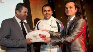 Bengal Spices owner Mizanur Chowdhury and chef Anand George collecting the award in Cardiff on Monday