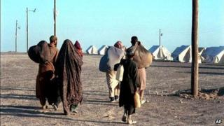 A group of Afghan refugees arrive at an Iranian Red Crescent refugee camp near the border with Iran, October 2001