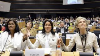 "Three Cuban ""Ladies in White"", Laura Maria Labrada Pollan, Belkis Cantillo Ramirez and Elena Larrinaga hold hands at the European Parliament in Brussels"