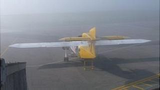 Plane at Alderney Airport in fog