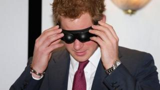 Prince Harry trying on goggles at Headway