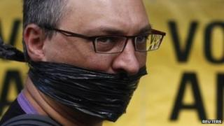 A protester looks on outside the ruling African National Congress (ANC) headquarters, during a protest against the passing of new laws on state secrets in Johannesburg, 22 November 2011.