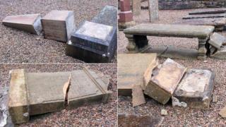 Smashed gravestones