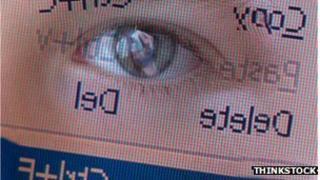 Eye reflected in computer screen