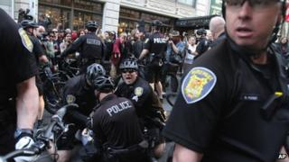 Police make an arrest at a May Day rally in Seattle, Washington 1 May 2013