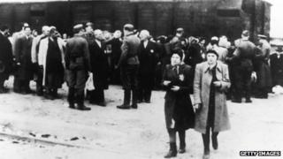 Newly arrived deportees and guards at the Nazi concentration camp at Auschwitz, Poland, circa 1943.