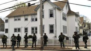 Police officers searching for Dzhokhar Tsarnaev