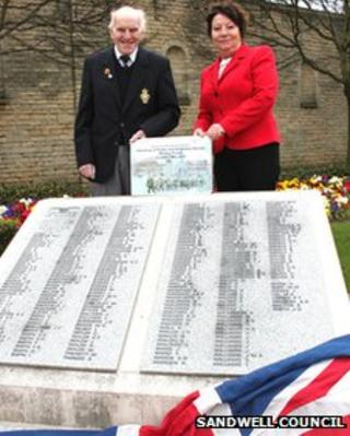 Tom Bedworth and Olwen Jones by a plinth dedicated to some of Wednesbury's fallen war heroes