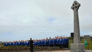 Male voice choir sings at memorial