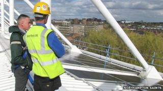 Solar panels being installed on roof of Northampton Saints' ground