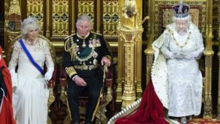 Camilla, Duchess of Cornwall and Prince Charles, Prince of Wales listen as Queen Elizabeth II delivers her speech during the the State Opening of Parliament