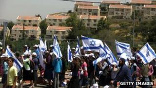 Israeli settlers march from the Ulpana outpost, in the West Bank settlement of Beit El, to the High Court of Justice in Jerusalem, on June 4, 2012.